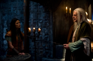 Perfidia (Natassia Malthe) and Tesselink (Christopher Lloyd) confer. Photo by Carol Segal and copyright by The Sci Fi Channel