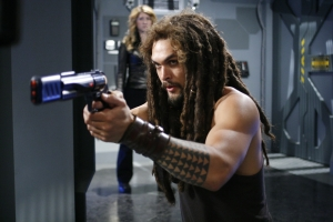 """Go ahead, make my day!"" Ronon sets his sights on yet another bad guy in the season five episode ""The Lost Tribe."" Photo by Eike Schroter and copyright The Sci Fi Channel"
