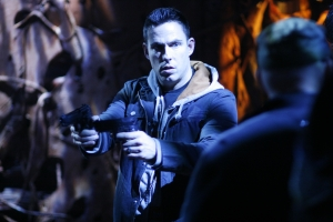 "Stargate Atlantis stunt coordinator James ""Bam Bam"" Bamford takes aim on the show's Vancouver, B.C. set. Photo courtesy of and copyright of MGM Studios"