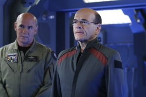 "Colonel Steven Caldwell (Mitch Pileggi) and Woolsey assess the situation onboard the Daedalus in ""First Contact."" Photo by Eike Schroter and copyright of the Sci Fi Channel"