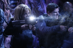 "Teyla and Major Lorne (Kavan Smith) defend themselves against some especially nasty Wraith in the season five Atlantis episode ""Infection."" Photo by Eike Schroter and copyright of the Sci Fi Channel"