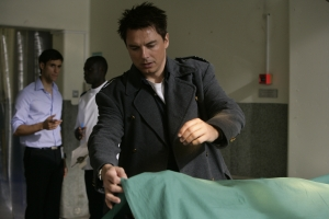 Jack (John Barrowman) falls for a trap set by Dr. Rupesh Patanjali (Rik Makarem). Photo courtesy of and copyright of the BBC