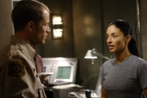 "Carter (Colin Ferguson) and Jo in a scene from ""Your Face or Mine."" Photo by Marcel Williams and copyright of The Syfy Channel"