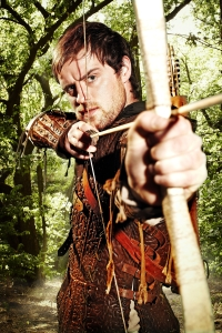Jonas Armstrong takes aim at the bad guys as Robin Hood. Photo copyright of Tiger Aspect Productions and the BBC