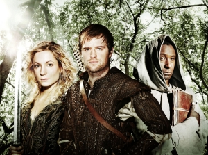 (L-R): Kate (Joanne Froggatt), Robin (Jonas Armstrong) and Tuck (David Harewood). Photo by Tiger Aspect Productions