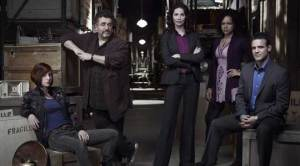 The cast of Warehouse 13 - Allison Scagliotti (Claudia), Saul Rubenik (Artie), Joanne Kelly (Myka Bering), Genelle Williams (Leena) and Eddie McClintock (Pete Lattimer). Photo copyright of The Syfy Channel