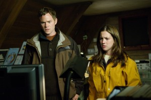 Atom (Ashmore) and Evelyn (Martha MacIsaac) try to figure out what's happening to them. Photo by Diyah Pera and copyright of Anagram Pictures